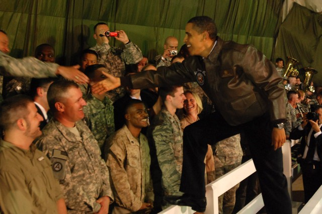 BAGRAM AIRFIELD, Afghanistan - The President of the United States Barack Obama greets deployed servicemembers and civilians during a surprise visit to Bagram Airfield, Afghanistan, Sunday night. During his visit he thanked the troops for all their hard work and dedication to the United States. Prior to Obama meeting the troops he flew to Kabul to meet with Afghanistan's President Hamid Karzai. (Photo by U.S. Army Staff Sgt. Susan Wilt, Combined Joint Task Force-82 Public Affairs)