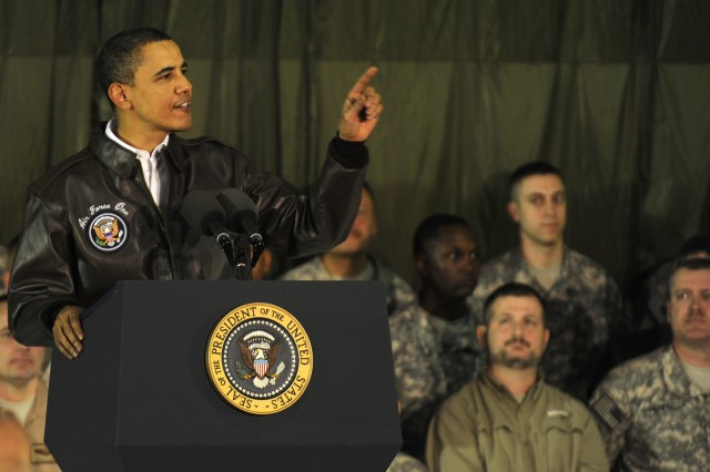 BAGRAM AIRFIELD, Afghanistan - The President of the United States Barack Obama gives a speech to servicemembers and civilians stationed at Bagram Airfield during surprise visit to Afghanistan, March 28. Prior to speaking to the troops, Obama flew to Kabul to meet with Afghanistan's president Hamid Karzai. (Photo by U.S. Air Force Tech. Sgt. Jeromy K. Cross, 455th Air Expeditionary Wing Public Affairs)
