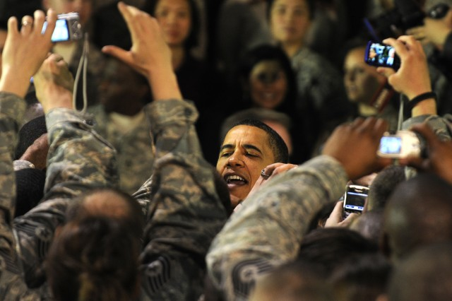 BAGRAM AIRFIELD, Afghanistan - The President of the United States Barack Obama greets deployed servicemembers and civilians during a surprise visit to Bagram Airfield, Afghanistan, Sunday night. During his visit he thanked the troops for all their hard work and dedication to the United States. Prior to Obama meeting the troops he flew to Kabul to meet with Afghanistan's President Hamid Karzai. (Photo by U.S. Air Force Tech. Sgt. Jeromy K. Cross, 455th Air Expeditionary Wing Public Affairs)