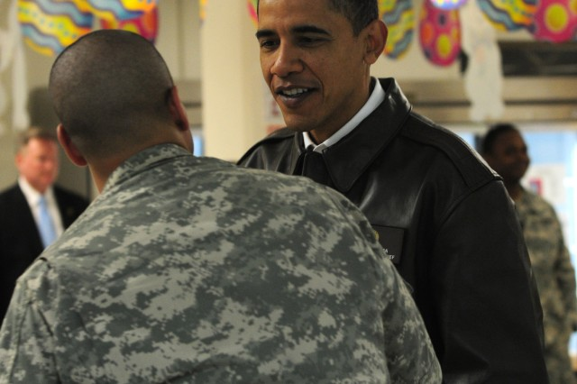 BAGRAM AIRFIELD, Afghanistan - The President of the United States Barack Obama greets a U.S. Army Soldier at Bagram Airfield's Dragon Dining Facility during a surprise visit to Afghanistan, early Monday morning. Earlier in the evening Obama addressed a crowd of deployed servicemembers and civilians and thanks them for the dedication and service to the United States. (Photo by U.S. Army Staff Sgt. Susan Wilt, Combined Joint Task Force-82 Public Affairs)