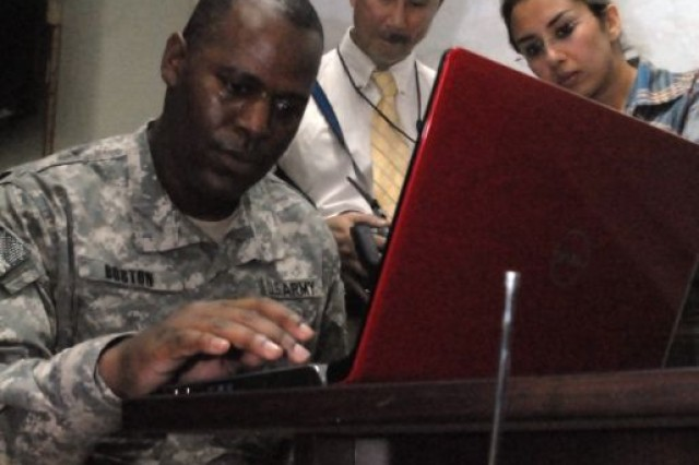 Lt. Col. Jonathan Boston, information operations officer, 3rd Heavy Brigade Combat Team, 3rd Infantry Division, attempts to log on to the internet at the School for Exceptional Students in Hillah, Iraq, March 16, 2010.  The 3rd HBCT and the Babil Provincial Reconstruction Team sponsored an event where students from the Iraqi school and Brookstone Academy, in Columbus, Ga., could talk to one another over the internet. Students from both schools were able to interact and ask each other questions.