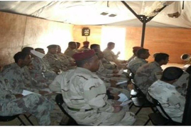 Students from the 38th Iraqi Army Brigade participate in the Maysan Literacy program.  The literacy class is an initiative of Company E, 121st Brigade Support Battalion, 4th Brigade, 1st Armored Division, deployed to Maysan Province, Iraq, to advise and assist Iraqi Security Forces.