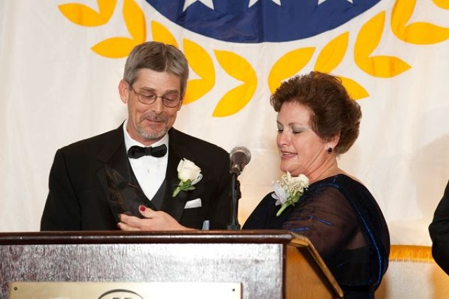 William White, left, is presented the 2010 Humanitarian of the Year award by AMVETS National Ladies Auxiliary President Patty Piening in a ceremony, March 20.