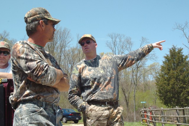 William White and Capt. Joe Bogart talk after a morning turkey hunt at Camp Hope, a hunting camp for injured servicemembers and veterans. White, the camp's founder, was recently named AMVETS 2010 Humanitarian of the Year.