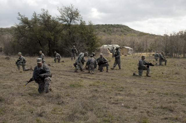 FORT HOOD, Texas- 1st Cavalry Division troopers prepare to begin their final reconnaissance mission, March 10. The course is designed to ready Ranger school hopefuls for the challenges they will face at the school.
