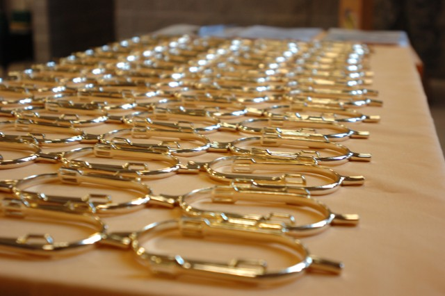 FORT HOOD, Texas - 'Golden Spurs' align a table before 89 Soldiers from the Division G2 section received them, March 25, at Belton Lake Recreational Area. Golden Spurs are award to Cavalry troopers for successfully completing a year-long deployment to Iraq. The spurs are a reminder of the 1st Cavalry Division's glorious past and tend to set apart the Cavalry Trooper from his more traditional brethren. The spurs evolved into a source of distinction to recognize the best of the cavalry Soldier.