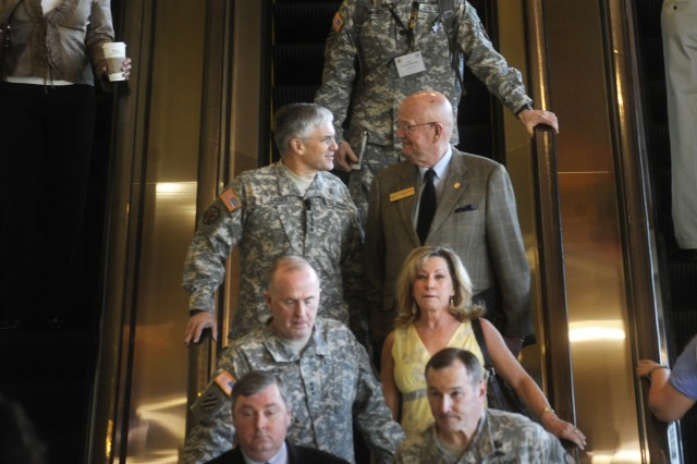 Chief of Staff of the Army Gen. George W. Casey Jr. and President of the Association of the United States Army (AUSA), retired Gen. Gordon Sullivan, go to the AUSA's 2010 Army Installations Symposium & Exposition in San Antonio, Texas, March 29, 2010. The exposition is being held in conjunction with the Army's Installation Management Command.
