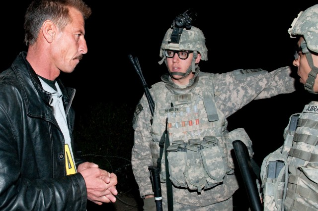 CAMP RAMADI, Iraq - Second Lt. Andrew Berreth, platoon leader of 3rd platoon, Company A, 1st Brigade Special Troops Battalion, 1st Brigade, 82nd Airborne Division (Advise and Assist), discusses threat activity with Iraqi police officer, 1st Lt. Haithem, at an IP check point near Ramadi, Iraq, March 23. Berreth's platoon clears routes of bombs along many of the main supply routes in Al Anbar province. (U.S. Army photo by Sgt. Michael J. MacLeod, 1/82 AAB, USD-C)