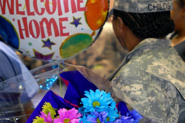 Soldiers were flooded with gifts as the 180th Transportation Battalion, 4th Sustainment Brigade returned home to Fort Hood in a redeployment ceremony at the Kieschnick physical fitness center Mar. 29. The unit supported Operation Iraqi Freedom in both Kuwait and Iraq during their ten-month deployment. (U.S. Army photo by Pfc. Sean McGuire)