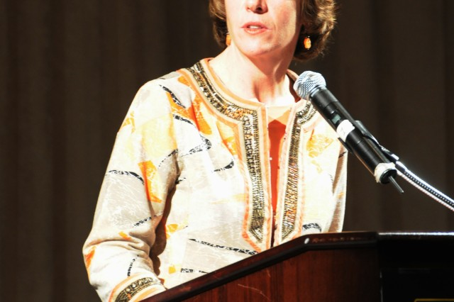 """Anne Munch, an attorney, subject matter expert, and speaker on sexual assault, addresses the audience during the third annual Army Sexual Harassment/Assault Response and Prevention summit in Arlington, Va., Monday, and explains the phenomenon of the """"unnamed conspirator"""" in sexual crimes."""