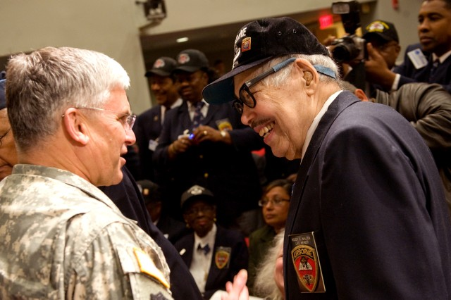 """Gen. George W. Casey Jr., chief of staff of the Army, talks with Roger Walden, one of the three survivors of the original """"Triple Nickles"""" unit, during a recognition ceremony at the Pentagon on March 25. The 555th Parachute Infantry Battalion, or """"Triple Nickles,""""was the nation's first all-black parachute infantry test platoon, company and battalion."""