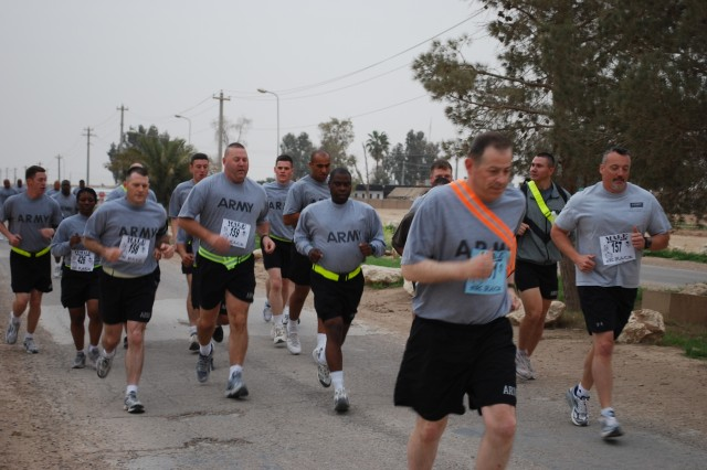CONTINGENCY OPERATING LOCATION Q-WEST, Iraq - Soldiers from Headquarters, 1st Squadron, 278th Armored Cavalry Regiment, and various other units, ran in the St. Patrick's Day fun run to get some physical training in and support their fellow Soldiers.