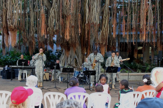 From left to right, Staff Sgt. Donald Scales, piano, Sgt. Jennifer Winston, vocalist (seated), Sgt. Juan Reyes, trumpet, Spc. Christopher Lafser, guitar, Staff Sgt. Ronald Strayhorn, drum set, Sgt. 1st Class Dwayne Simmons, Alto Saxophone, Spc. Anthony Santos, Tenor Saxophone, Staff Sgt. Troy Swanson, bass, all members of the 25th Infantry Division Jazz Combo performed a variety of jazz music for guests at the Hale Koa Hotel, Honolulu, underneath the banyan tree. They perform at the Hale Koa at least twice a month.  Call the 25th ID Band Operations at 655-9759 for more information. (Photo courtesy of the 25th Infantry Division Band)
