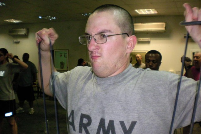 Spc. Thomas Spivey, with the 422 Civil Affairs Battalion, conducting the scarecrow with resistance bands