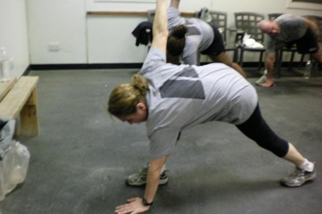 Dee Khoshaba conducting a forward lunge stretch.