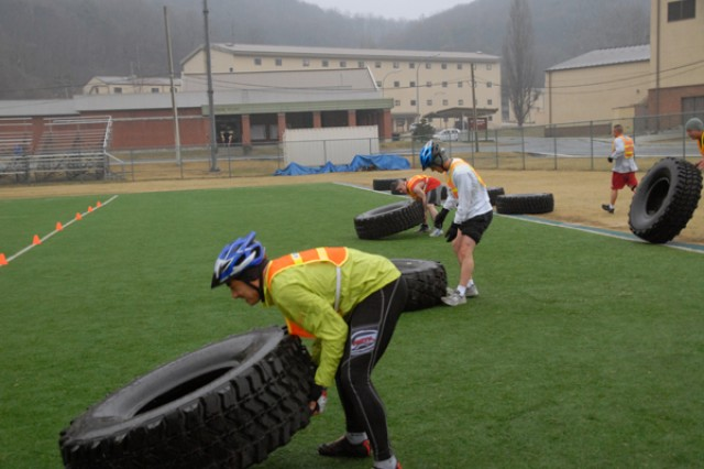Warriors vigorously throw tires during an Ultra Fitness Challenge event March 27.