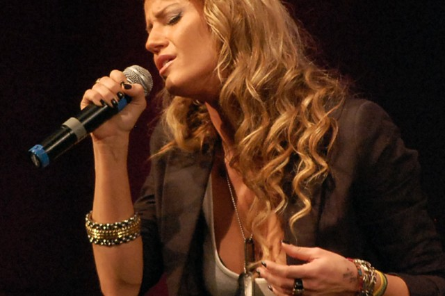 Leigh Jones croons a ballad to an audience of more than 200 Soldiers, family members and civilians at the Grafenwoehr Performing Arts Center, March 19.