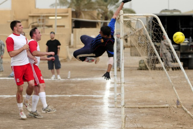 BAGHDAD - The 5th Brigade Federal Police goalie jumps for a ball during a game against 5th Squadron, 7th Cavalry Regiment, on Forward Operating Base Falcon March 25. (U.S. Army photo by Spc. Jared Eastman, 1st BCT-A, 3rd ID, USD-C)