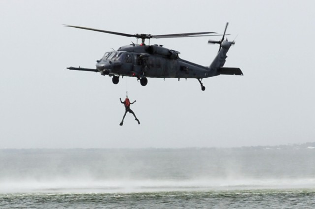 PATRICK AIRFORCE BASE, Fla. - Pararescuemen with the 308th Rescue Squadron demonstrate a water-based rescue here from a HH-60G Pave Hawk helicopter for the 911th Airlift Wing Honorary Commander's Association. The 308th falls under the command of the 920th Rescue Wing based here. (U.S. Army Photo by Spc. Michael T. Crawford, 316th ESC Public Affairs Office)