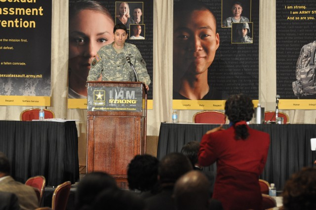 Col. Joe Gill, U.S. Army EuropeAca,!a,,cs assistant deputy chief of staff for personnel, addresses the crowd at the third annual Army Sexual Harassment/Assault Response and Prevention summit in Arlington, Va., Tuesday.