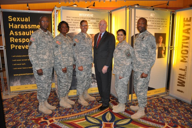 Sgt. Maj. Michael Brown; Master Sgt. Verlean Brown, 2008 Sexual Assault Response Coordinator of the Year; Brig. Gen. Jeffrey C. Horne, Director, Army Human Resources Policy Directorate; the Honorable Thomas R. Lamont, Assistant Secretary of the Army (Manpower & Reserve Affairs); and Master Sgt. Rita Cossio, 2009 Sexual Assault Response Coordinator of the Year at the third annual Army Sexual Harassment/Assault Response and Prevention summit in Arlington, Va., Wednesday.
