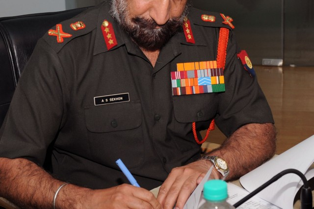 Indian Army Lt. Gen. AS Sekhon, director General Military Operations, signs meeting minutes signaling the agreement of upcoming bilateral exercises and scholarly exchanges with the U.S. Military at the completion of the 14th Executive Steering Group in Chandigarh, India, March 23. The goal of the annual two-day conference is to discuss and solidify the upcoming bilateral engagements between the two countries.