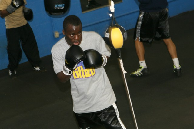 Sgt. George Yeanue, supply sergeant, Company D, 1st Battalion, 5th Cavalry Regiment, 1st Calvary Division, Fort Hood, Texas, slips a double-end bag during an All-Army Boxing workout.