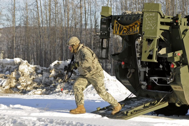 A Soldier with the 73rd Engineer Company dismounts a Stryker during a recent dismount squad clearing exercise March 25 at the Pvt. Joseph P. Martinez Combined Arms Collective Training Facility, Fort Wainwright, Alaska.