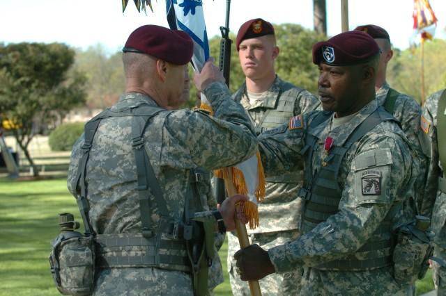 Outgoing Command Sgt. Maj. Joseph R. Allen passes the XVIII Airborne Corps to Lt. Gen. Frank Helmick
