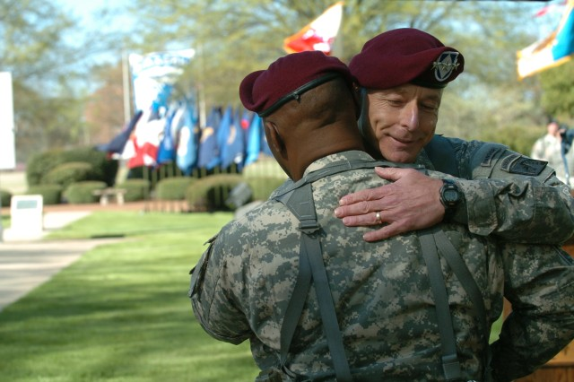 FORT BRAGG, N.C. - Lt. Gen. Frank Helmick, commanding general, XVIII Airborne Corps and Fort Bragg, embraces his outgoing senior enlisted advisor, Command Sgt. Maj. Joseph R. Allen, during Allen's change of responsibility ceremony here today. (U.S. Army photo by Spc. A.M. LaVey / XVIII Airborne Corps)