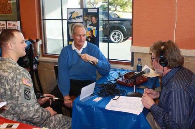 PRESIDIO OF MONTEREY, Calif. - Staff Sgt. Carl Barfuss, McDonaldAca,!a,,cs owner Landon Hofman and radio host Kahl discuss the purpose of the check that Hofman had just presented to Barfuss.