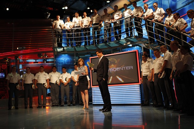 "Hannah Storm and Josh Elliott, co-hosts of ""Sports Center"" invite West Point cadets on the ESPN set. Twenty-nine cadets toured the ESPN complex at Bristol, Conn., for a behind-the-scenes look into sports television broadcasting March 31. Photo by Tommy Gilligan"