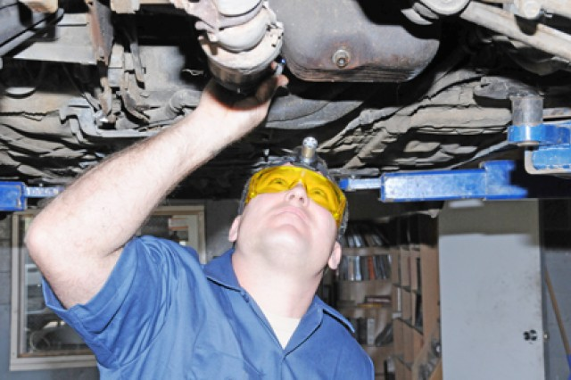 Eric Jason Daum, a Fort Rucker Automotive Skills Center mechanic, tunes up a client's car March 24. Officials say properly maintaining vehicles is important to achieving maximum efficiency, saving energy and money.