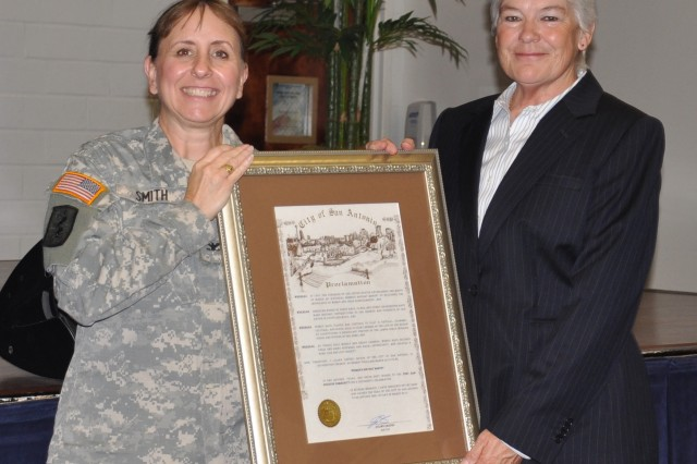 Col. Dawn Smith, chief of staff, U.S. Army Medical Department Center & School presents retired U.S. Army Reserve Command Sgt. Maj. Sueanne Pierce a framed Women's History Month Proclamation signed by San Antonio Mayor Julian Castro. Pierce was the guest speaker for the post-wide event commemorating women's history March 30 at Army Community Service, Fort Sam Houston, Texas.