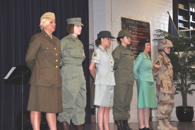 """Soldiers dressed in various Army uniforms representing different periods in history stood on the stage as Staff Sgt. Danielle Smith read her poem titled, """"Write Me Off,"""" during the Women's History Month commemoration March 30 at Army"""