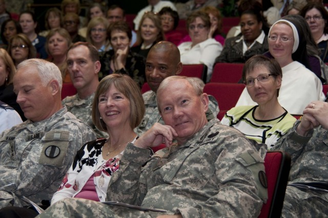 Gen. Martin E. Dempsey, commanding general of U.S. Army Training and Doctrine Command, listens to the speakers of the Women's History Month Observance on Fort Monroe, Va., March 29, 2010. TRADOC and 633d Air Base Wing hosted the Women's History Month Observance with guest panelists Honorable Thelma Drake; Gen. Ann E. Dunwoody, commanding general of U.S. Army Materiel Command; Susan Kilrain; and Cmd. Sgt. Maj. Teresa King.