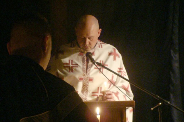 Chaplain (Capt. Michael) Wikstrom performs an Eastern Orthodox service in Kabul, Afghanistan