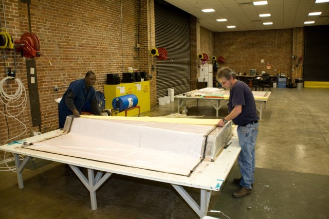 Fabric workers create ABV panels