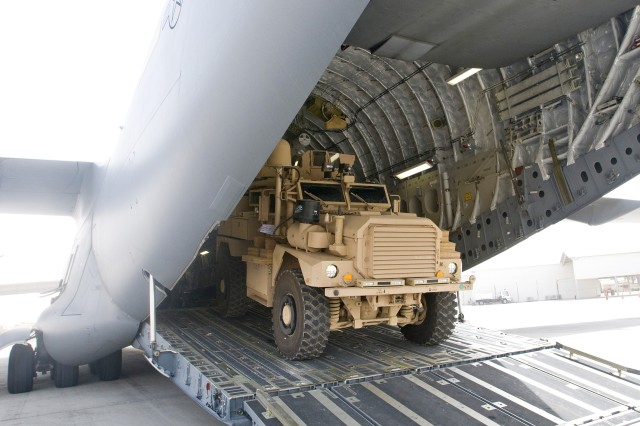 One of many Mine Resistant Ambush Protected vehicles destined for Afghanistan is loaded into the back of a C-17 Globemaster III aircraft at an airbase within Third Army's Area of Responsibility.  Third Army, in partnership with the U.S. Forces - Afghanistan, provides continuous, uninterrupted world-class sustainment operations for U.S. and coalition forces.  Third Army plays a key role in providing the necessary command and control and common operating picture for building up forces in Afghanistan and setting the conditions to restore strategic readiness in the Army