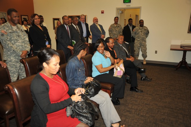 Seated from left to right, members of Linda Bynum-Knight's family Dana (daughter), Brandi (granddaughter), Darlene (daughter), Darryn (son) and Charlie (husband) and standing, members of the Joint Force Headquarters - National Capital Region and The U.S. Army Military District of Washington and guests.