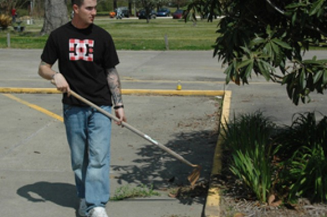 Staff Sgt. Kirk Bolger, a platoon sergeant for 2nd Battalion, 4th Infantry Regiment, 4th Brigade Combat Team, 10th Mountain Division, uses a hoe while helping beautify the area in front of Rosepine Retirement and Rehabilitation Center during a community-service project in Rosepine March 18.