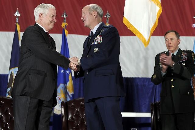 Defense Secretary Robert M. Gates congratulates U.S. Air Force General Duncan McNabb, commander U.S. Transportation Command, after attaching the Joint Meritorious Unit Award on the USTRANSCOM guidon on Scott Air Force Base, Ill., April 1, 2010.