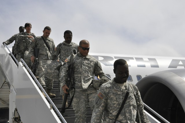 Soldiers from the 10th Transportation Company, 3rd Sustianment Brigade, 3rd Infantry Division, return to Hunter Army Airfield from Haiti, March 28. The 10th Trans Co left for Haiti Jan. 23 to assist the earthquake-ravaged country.