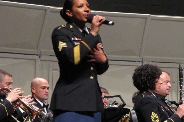 """Sgt. Ericka Escalante sings """"Pack Up Your Troubles"""" during the AMC Band's Community Appreciation Concert on March 21."""