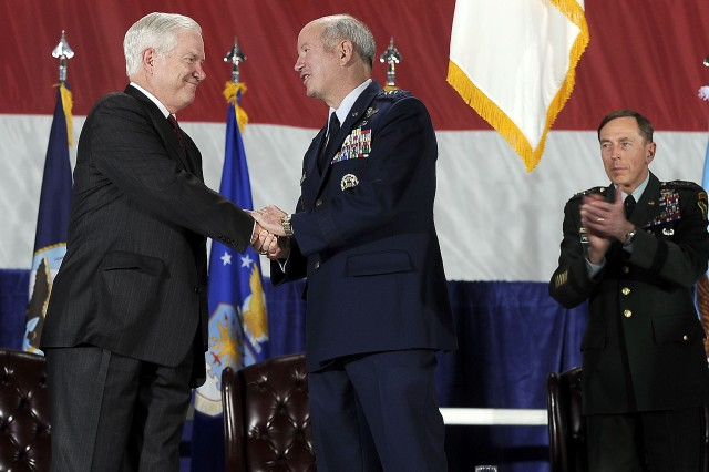 Defense Secretary Robert M. Gates congratulates U.S. Air Force General Duncan McNabb, commander U.S. Transportation Command, after attaching the Joint Meritorious Unit Award on the TRANSCOM guidon during a ceremony on Scott Air Force Base, Ill., April 1, 2010.