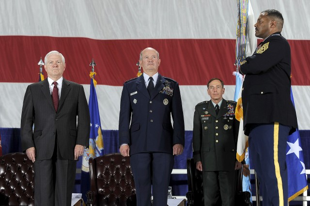 U.S. Defense Secretary Robert M. Gates and U.S. Air Force General Duncan McNabb, commander of U.S. Transportation Command (TRANSCOM), stand at attention during a ceremony to present TRANSCOM the Joint Meritorious Unit Award, Scott Air Force Base, Ill., April 1, 2010.