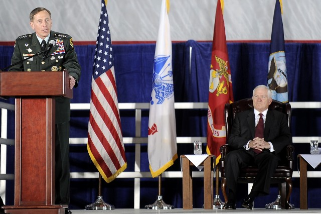 U.S Army Gen. David H. Patraeus, commander, U.S. Central Command, gives his remarks while Defense Secretary Robert M. Gates looks on before honoring the U.S. Transportation Command with the Joint Meritorious Unit Award during a ceremony on Scott Air Force Base, Ill., April 1, 2010.