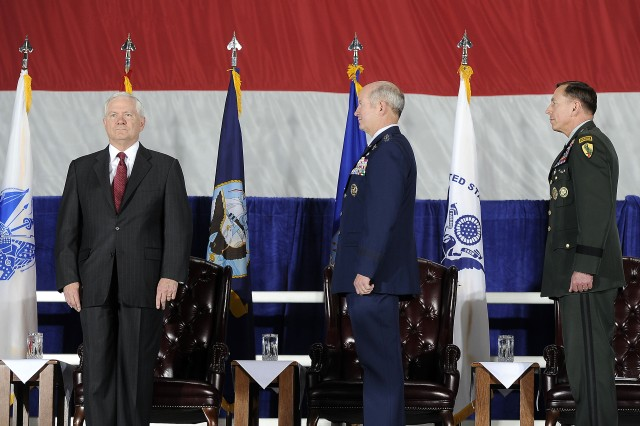 Defense Secretary Robert M. Gates, left, stands with U.S. Air Force General Duncan McNabb, commander U.S. Transportation Command (TRANSCOM), and U.S Army Gen. David H. Patraeus, commander of U.S. Central Command, prior to presenting TRANSCOM with the Joint Meritorious Unit Award during a ceremony on Scott Air Force Base, Ill., April 1, 2010.