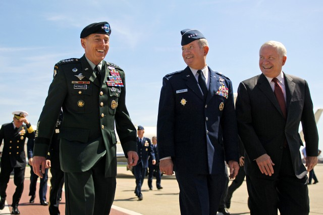 Defense Secretary Robert M. Gates, right, walks with Army Gen. David H. Patraeus, commander, U.S. Central Command, left, and Air Force Gen. Duncan McNabb, commander U.S. Transportation Command (TRANSCOM), center, prior to awarding TRANSCOM with the Joint Meritorious Unit Award during a ceremony on Scott Air Force Base, Ill., April 1, 2010.