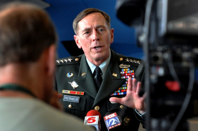 Gen. David H. Patraeus, commander of U.S. Central Command, answers questions from members of the press after a ceremony on Scott Air Force Base, Ill, during which Defense Secretary Robert M. Gates presented the U.S. Transportation Command with the Joint Meritorious Unit Award, April 1, 2010.